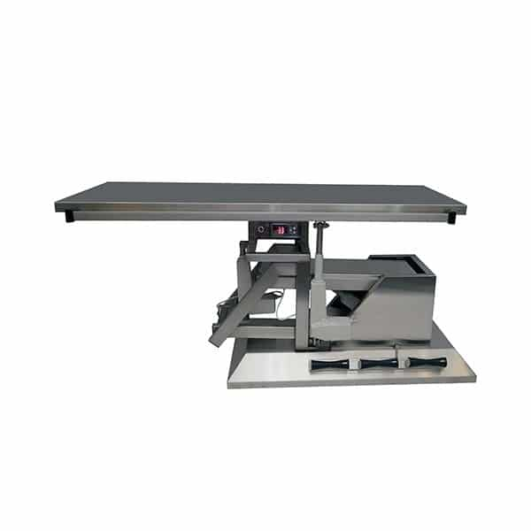 Surgery table with third direction tilt and flat warming top