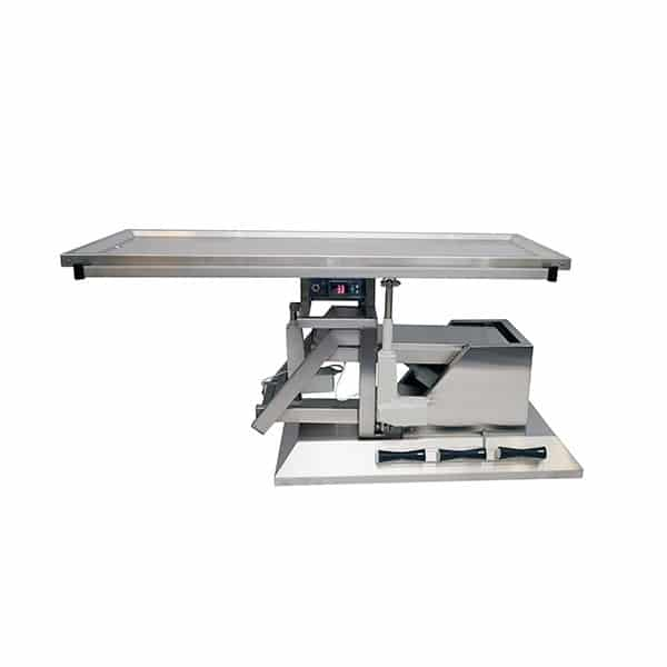 Surgery table with third direction tilt and warming plate with two drains